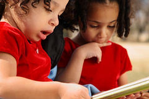 Little Arrows Child-care Pre-School program children reading book